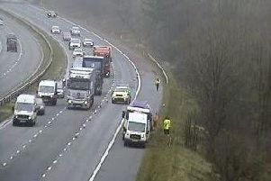 Police have closed a stretch of M6 between Preston and Lancaster after a lorry pulled onto the hard shoulder with a damaged tyre.