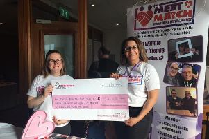 Lizzie Winkfield and Lucy Hamlin with the cheque