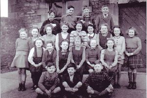 Wray School pupils, junior class, circa 1948. Back row from left: Joseph Woodhouse (Scale Farm, Roeburndale East), George Preece (Thornbush Farm, Roeburndale West), Alan Cornthwaite (No 1, Moor Cottage, Wray), Frank Harrison (Birks Farm, Botton.) Third row from left: Hazel Pritchard (The Cross, Wray), Ruby Atkinson (Crag Hall, Botton), Nora Cornthwaite (No 1, Moor Cottage, Wray), Margaret Mashiter (Harterbeck Farm, Roeburndale East), Margaret Huddleston (Procter's Farm, Wray), Joyce Kenyon (No 1, Holme View, Wray), Margaret Kenyon (Moor House, near Wray), Jean Whittam (Bridge End, Wray), Jean Fox (George and Dragon Public House, Wray). Second row from left: Lucy Gorst (Bellhurst Farm, Roeburndale East), Winnie Stephenson (Above Beck Farm, near Wray), Brenda Ralston (Roeburn Terrace, Wray), Edith Gorst (Bellhurst Farm, Roeburndale East), Margaret Wilson (Bridge End, Wray), Jill Kenyon (No 1, Holme View, Wray). Front row from left: David Ralston (Roeburn Terrace, Wray), Ted Holmes (Barkingate Farm, Roeburndale