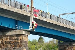 The photographer being rescued off Carlisle Bridge. Photo by Leanne Marie Owens.