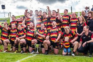 Kirkby Lonsdale rugby club. Picture was taken at the end of the 2016/2017 season when Kirkby went undefeated throughout the season and racked up the highest points total in all English rugby that season. Skipper Ben Walker dealing with the champagne and his proud mum Ruth looking on in the hat.