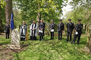 A service is held at the grave of police sergeant John Hately, who died in 1875 after being struck by a missile during a riot in Alnwick. Picture by Jane Coltman