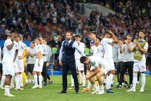 LEADING MAN: Gareth Southgate consoles his players after their World Cup semi-final defeat to Croatia. Picture: Adam Davy/PA
