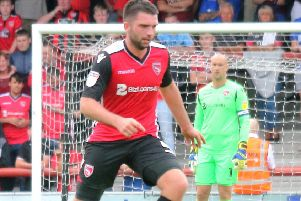 Alex Kenyon was back in pre-season training with Morecambe despite no new contract having been agreed