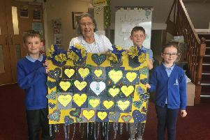 Pupils from Barnacre Road Primary School, Longridge  present their Denim for Dementia artwork to their neighbours at the Longridge Hall and Lodge Care Home