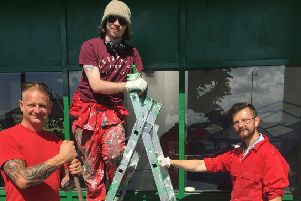 Firefighter Michael Parker, Kailen Phillips and Giles Sowerby work on the former bus waiting room on Central Drive, Morecambe, which has been turned into a hangout shelter for young people in the town.