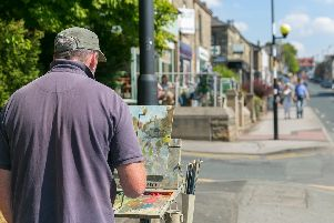 Adam Ralston painting a street scene at last year's event