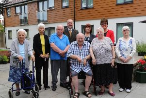 Chesterfield Borough Council's chief executive, Huw Bowen; cabinet member for housing, Councillor Chris Ludlow and leader, Councillor Tricia Gilby with residents at the newly-reopened Glebe Court.