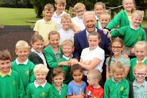 Orchard Primary and Nursery School's head teacher Rob Cook is pictured with some of his pupils before retiring after 13 years at the school.