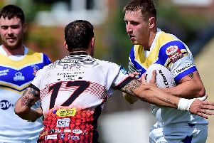 Batley Boys Aaron James looks for a way past Eastmoor defender Michael Jedynak during last Saturday's National Conference Division Three clash at Halifax Road. Pictures: Paul Butterfield