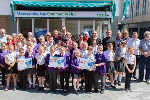 Mal Garnett nd Annette Smith at the opening of the Morecambe Bay Uniform Bank.