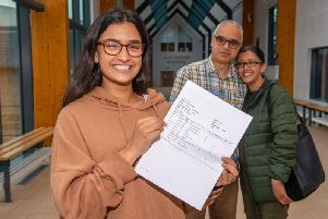 Zehra Khan and her parents Mahmood and Shazia celebrating her results. Photo provided by Bradford Grammar School.