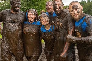 Mucky fund-raisers from Wigan take part in the Tough Mudder race to raise money and awareness for Mind