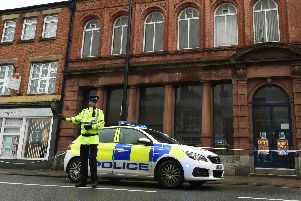 Police at the scene on King Street in Leigh