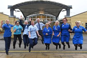 Dr Alan Brown, centre, leaps with some of the nurses from the hospice