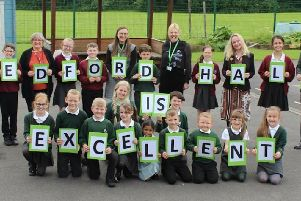 Staff and pupils from Westleigh and Bedford Hall Methodist primary schools, in Leigh, celebrate