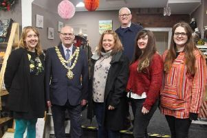 Mayor of Wigan Coun Steve Dawber with staff at the new shop