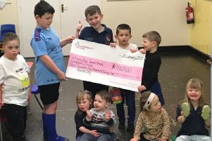 Children at Happy Days special needs community group celebrate receiving a grant from National Lottery