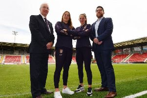 Wigan Council leader David Molyneux, England players Mary Earps and Abbie McManus and head of tournament delivery Chis Bryant at Leigh Sports Village when it was announced as a competition venue last summer