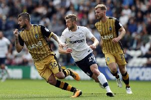 Tom Barkhuizen pursues Sheffield Wednesday's Daniel Pudil in PNE's 1-0 win over the Owls last August