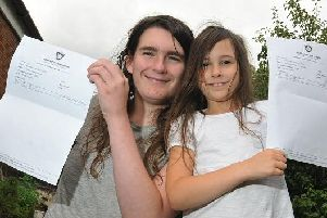 Thomas (left) and Ellie with their certificates