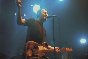 Joe Strummer, former frontman with punk icons The Clash, on stage with his later band, the Mescaleros