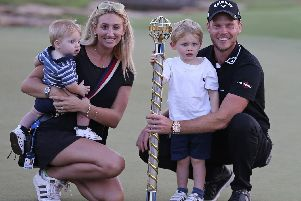 Danny Willett, his wife Nicole and their children pose with the trophy after he won the DP World Tour Championship golf tournament in Dubai, United Arab Emirates, Sunday, Nov. 18, 2018. (AP Photo/Kamran Jebreili)