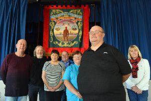 Horden Banner Committee has unveiled the village's new banner. Front is chairman Robert Dowson with committee members.