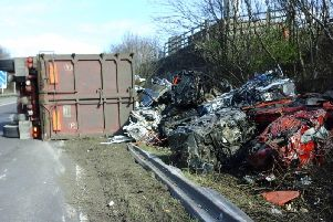 The Junction 25 eastbound slip on the M62 is closed after a HGV carrying crushed cars overturned. Photo credit: Highways England