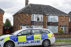 Police officers and scenes of crime officers at a property in Orgreave Lane Sheffield, where Allan Grayson, 85, was fatally stabbed
