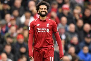 LIVERPOOL, ENGLAND - APRIL 14:  Mohamed Salah of Liverpool reacts during the Premier League match between Liverpool FC and Chelsea FC at Anfield on April 14, 2019 in Liverpool, United Kingdom. (Photo by Michael Regan/Getty Images)