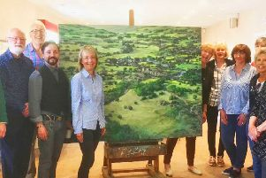 Members of SAG with Enrique Azocar and his painting depicting an amalgamation of areas in Northumberland.