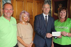 Former Mayor and Mayoress of Burnley Coun. Charlie Briggs and Mrs Patricia Lunt present a cheque for 3,600 to David and Fiona King of BK's Heroes.