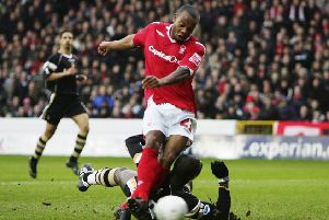 NOTTINGHAM, UNITED KINGDOM - JANUARY 06:  Junior Agogo of Nottingham Forest gets his shot in ahead of Souleyman Diawara of Charlton Athletic to open the scoring during the the FA Cup sponsored by E.ON Third Round match between Nottingham Forest and Charlton Athletic at the City Ground on January 6, 2007 in Nottingham, England.  (Photo by Laurence Griffiths/Getty Images)