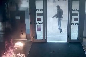 Shocking footage shows the man brandishing a meat cleaver before dousing the bank in petrol and setting it alight (Video made available by the CPS)