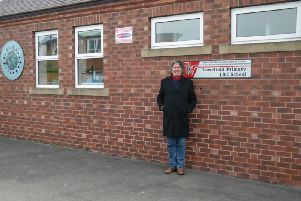Theatre director and author Clive Moffatt outside his old school in Wakefield.
