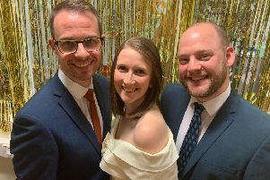 Anna with her husband Ben Kenny (left) and cast mate Karl Roe (right).
