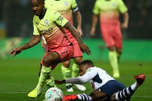 Raheem Sterling leaves Darnell Fisher on the floor in Preston's Carabao Cup defeat to Manchester City at Deepdale