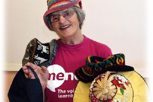 Charity fundraiser Pat Ascroft with a selection of hats collected on her expeditions