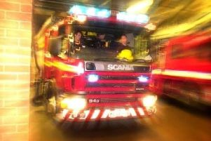 Firefighters releases a person from a vehicle on the M61 at Chorley