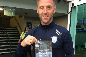 Preston's Paul Gallagher with a copy of North End Souls