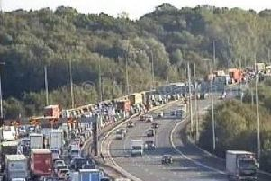 Southbound queues on the M6 near Preston (Image: Highways England)