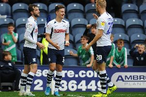 Josh Harrop is congratulated by Jayden Stockley and Tom Barkhuizen after scoring Preston's fifth goal against Barnsley
