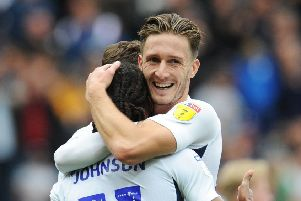 Ben Davies congratulates Daneil Johnson on scoring Preston's opening goal against Barnsley