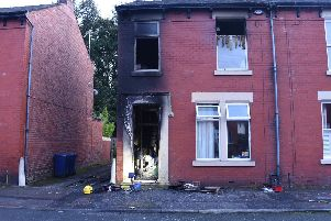 Firefighters are damping down after the blaze took hold of the ground floor entrance hall and first floor of a terraced house on Margaret Road.
