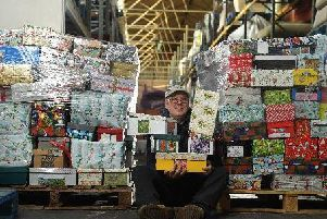 Paul Dufton, warehouse operator at International Aid Trust, getting ready for the Send a Smile shoebox appeal.