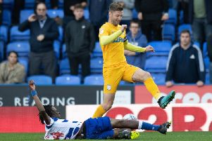 Paul Gallagher is tackled by Reading's Ovie Ejaria