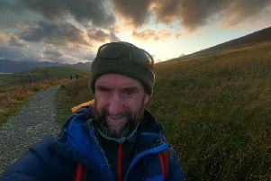 James Coulton is pictured walking up Skiddaw as part of his training for Trek Peru.