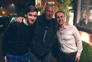 Sir Ian 'Beefy' Botham with staff at The Plough in Scalby