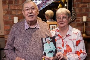 Ken and Kath Downing, of Leyland, celebrating their 60th wedding anniversary. They are pictured with their card from the Queen.